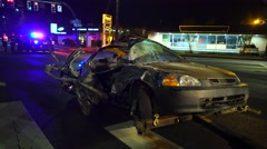 Mangled Car With Emergency lights In The Background Stock Footage