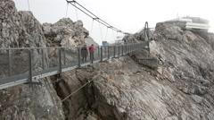Suspension bridge over the precipice in Alps mountains - Dachstein, Austria - stock footage
