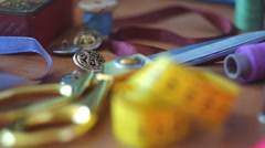 Sewing supplies scattered on the table Stock Footage