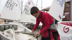 The young sailor boy mounted the sail Stock Footage