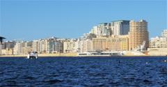Catamaran crossing Marsamxett Harbour, Valletta, Malta Stock Footage