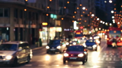Background with blurry unfocused city lights and driving cars. Gran Via, Murcia - stock footage