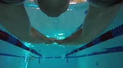 An underwater FPV shot of man swimming the breast stroke Stock Footage