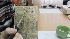 A technician working on a chip with a soldering iron Stock Footage