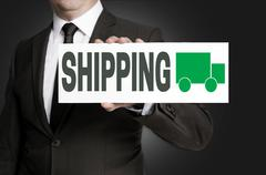 shipping sign is held by businessman background - stock photo