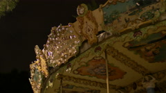 Close up view of a carousel's decorations in Nice at night - stock footage