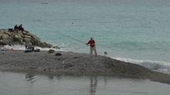 Men fishing on the sea in Nice Stock Footage