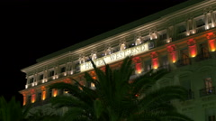 West End Hotel on Promenade des Anglais in Nice at night Stock Footage