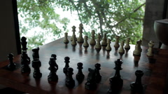 Wooden Chess Board With Trees And Window In Background Stock Footage