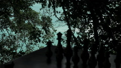 Wooden Chess Board Silhouette With Trees And Sea Ocean Waves In Background - stock footage