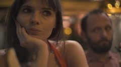 Offended, bored couple sitting in cafe and drinking cocktails at night Stock Footage
