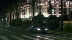Tilt up view of Le Negresco Hotel in Nice at night Stock Footage