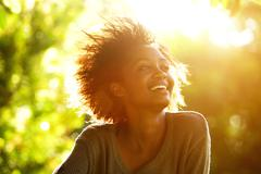 Beautiful african american woman smiling with sunset Stock Photos
