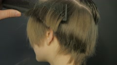 Barber doing a haircut with scissors - stock footage