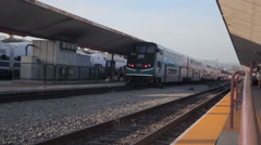 Wide view of train leaving LA Union Station platform - stock footage