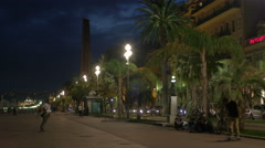 Longboarding, roller skating and jogging on Promenade des Anglais at night,Nice Stock Footage