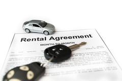 Car rental agreement with car on center - stock photo