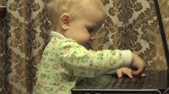 Cute Newborn Little Girl Works Personal Computer. 4K UltraHD, UHD - stock footage