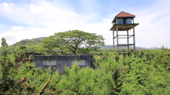 Abandoned Hotel Building Overgrown Plants Water Tower Trees Forest Stock Footage