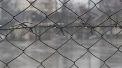 Downpour on sport court, view through the chain-link fence. Wire fence and rain. Stock Footage