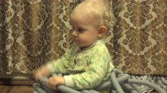 Closeup Baby Girl Sitting in Electrical Corrugated Tube. 4K UltraHD, UHD - stock footage