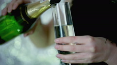 Woman pouring schampagne to the glass, steadycam shot - stock footage
