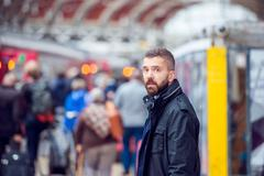 Hipster man waiting at the crowded train station Stock Photos