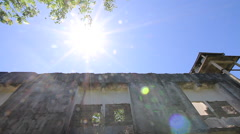 Abandoned Hotel Building Water Tower Sunlight Lens Flare Stock Footage
