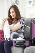 Pregnant Woman Packing Suitcase For Trip To Hospital Kuvituskuvat
