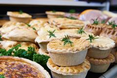 Close Up Of Baked Savoury Goods In Delicatessen - stock photo