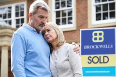 Mature Couple Forced To Sell Home Through Financial Problems Stock Photos