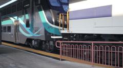 Metrolink train leaving LA Union Station platform - stock footage