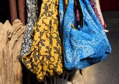 Cute colorful handmade fabric bags - stock photo