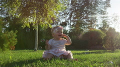 Baby Girl Grass Bubble Burst Arm - 4k - Slow motion Stock Footage