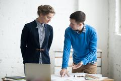 Teamwork at architectural agency Stock Photos