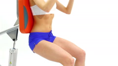 Slender woman shakes her abdominal muscles Stock Footage