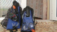Two backpacks with snorkeling gear at entrance to hotel room at beach resort Stock Footage