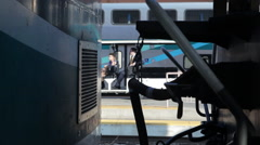Cart with passengers passes the train in terminal at Union Station - stock footage