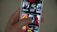 Netflix on mobile phone Stock Footage
