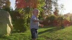 Young Boy Poke Bubbles Sunlight - 4k - Slow motion Stock Footage