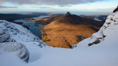 Scottish mountains in winter with golden light at sunrise Stock Footage