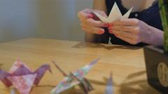 Girl Folding Yellow Crane Origami Stock Footage