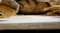 Slow motion of sifting flour over wooden table Stock Footage
