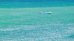 Locals on Small Fishing Boat Floating on Tropical Ocean Stock Footage