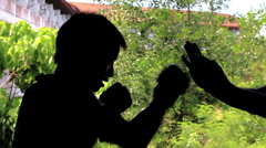 Silhouette MMA Fighter Muay Thai Boxing Punching Drills Against Trainers Hands - stock footage