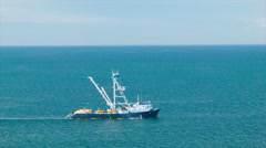 Big Blue Open Pacific Ocean with Fishing Boat Close-up Shot Stock Footage