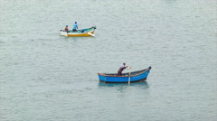 Peruvian Locals in Small Fishing Boats Rowing Stock Footage