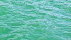 Green Ocean Water Swirling in the Bay Close-up Stock Footage