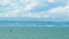 Wide Ocean Scene in Costa Rica with Industrial Sea Port Stock Footage