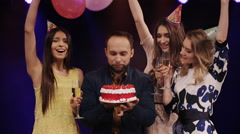 Birthday boy blows out the candles on the cake, a dance club in the spotlight Stock Footage